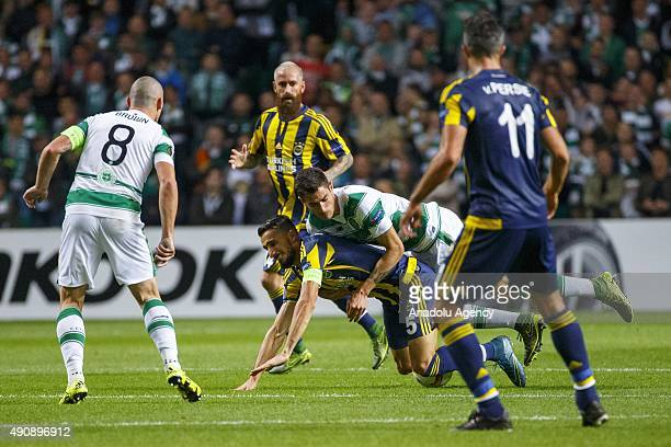 Celtics Scott Brown vies with Fenerbahces Mehmet Topal during the UEFA Europa League Group A match between Celtic FC and Fenerbahce at Celtic Park in...