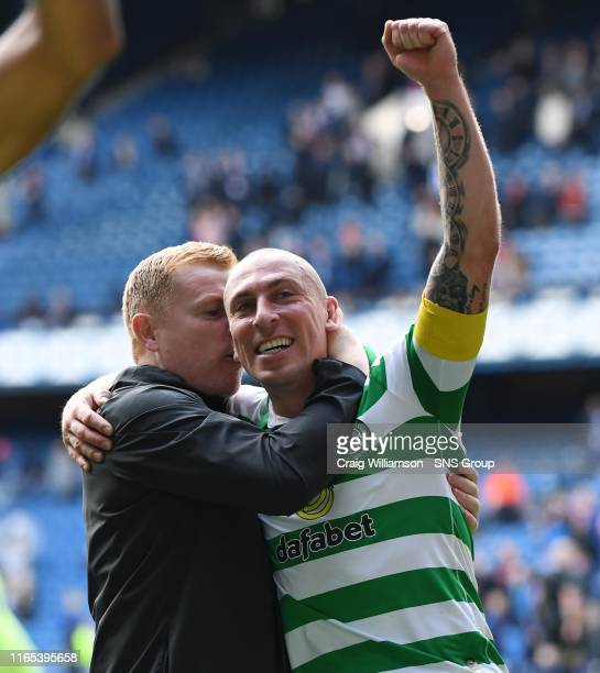 Celtic's Scott Brown with manager Neil Lennon at full time during the Ladbrokes Premier match between Rangers and Celtic at Ibrox Stadium, on...