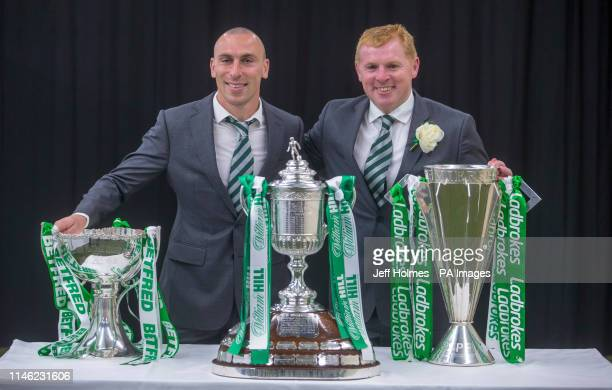 Celtic's Scott Brown with manager Neil Lennon celebrate with the trophy for winning the Treble Treble during the William Hill Scottish Cup Final at...