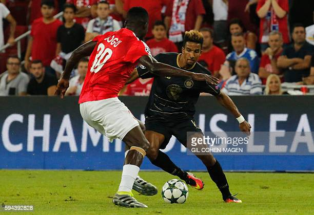 Celtic's Scott Sinclair dribbles the ball as Hapoel's John Ogu defends during the UEFA Champions League group stages playoff football match between...
