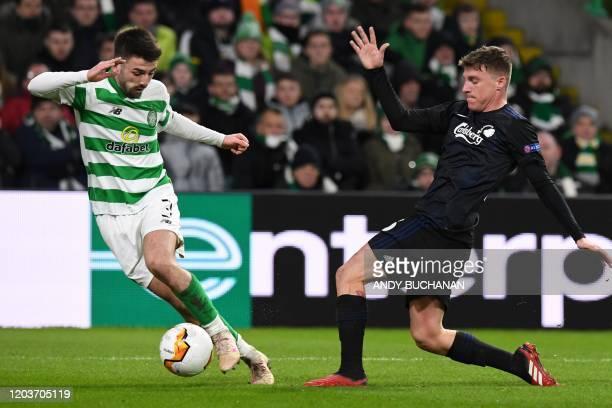 Celtic's Scottish defender Greg Taylor vies with FC Copenhagen's Spanish midfielder Pep Biel during the UEFA Europa League round of 32 second leg...