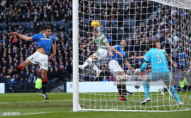 Celtic's Scottish forward Leigh Griffiths scores during the Scottish League Cup SemiFinal football match between Celtic and Rangers at Hampden Park...