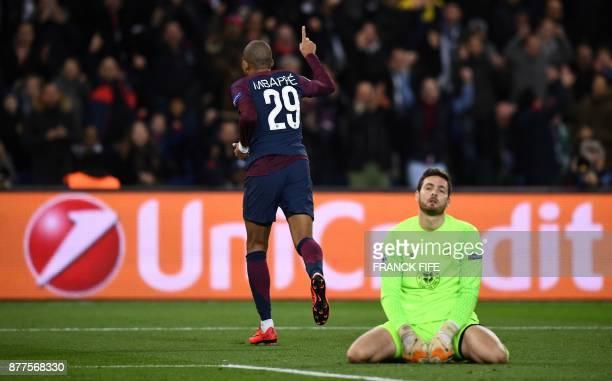 TOPSHOT Celtic's Scottish goalkeeper Craig Gordon looks on as Paris SaintGermain's French striker Kylian Mbappe celebrates scoring his team's fourth...