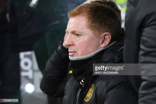 Celtic's Scottish head coach Neil Lennon awaits kick off in the UEFA Europa League round of 32 second leg football match between Celtic and...