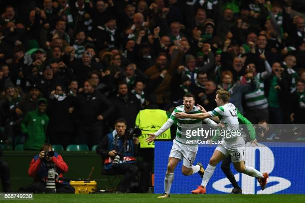 Celtic's Scottish midfielder Callum McGregor celebrates with Celtic's Scottish midfielder James Forrest after scoring during the UEFA Champions...
