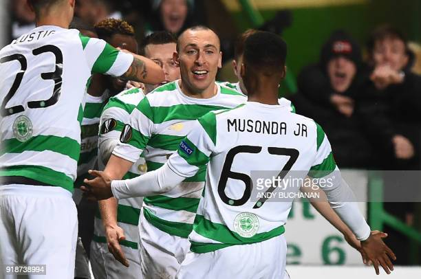 Celtic's Scottish midfielder Callum McGregor celebrates with teammates scoring the team's first goal during the UEFA Europa League football match...