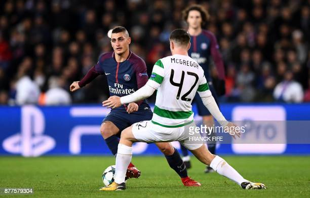 Celtic's Scottish midfielder Callum McGregor fights for the ball with Paris SaintGermain's Italian midfielder Marco Verratti during the UEFA...