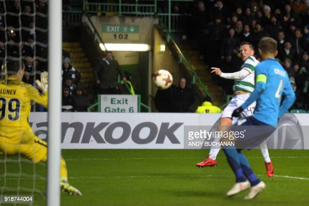 Celtic's Scottish midfielder Callum McGregor scores the team's first goal during the UEFA Europa League football match between Celtic and Zenit Saint...
