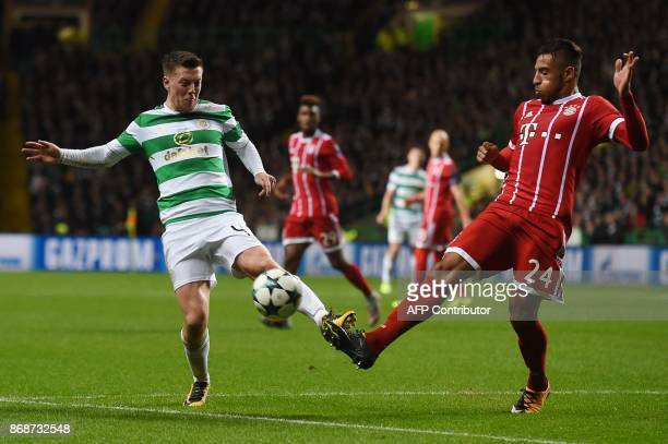 Celtic's Scottish midfielder Callum McGregor vies with Bayern Munich's French midfielder Corentin Tolisso during the UEFA Champions League Group B...