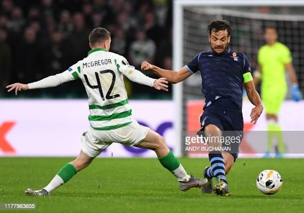 Celtic's Scottish midfielder Callum McGregor vies with Lazio's Italian midfielder Marco Parolo during the UEFA Europa League group E football match...