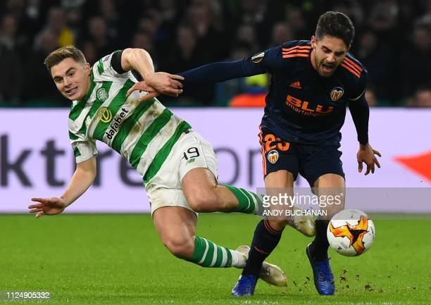 Celtic's Scottish midfielder James Forrest battles with Valencia's Spanish forward Ruben Sobrino during the UEFA Europa League round of 32 first leg...