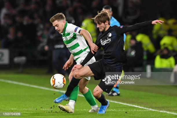 Celtic's Scottish midfielder James Forrest vies with FC Copenhagen's Danish midfielder Rasmus Falk during the UEFA Europa League round of 32 second...