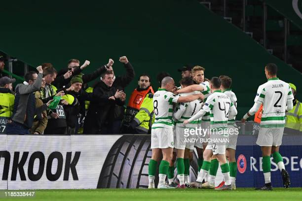 Celtic's Scottish midfielder Lewis Morgan celebrates with teammates after scoring the opening goal of the UEFA Europa League group E football match...