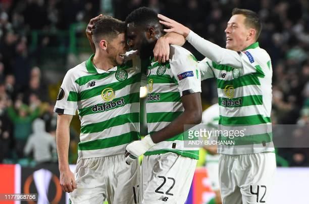 Celtic's Scottish midfielder Ryan Christie celebrates with Celtic's French forward Odsonne Edouard and Celtic's Scottish midfielder Callum McGregor...