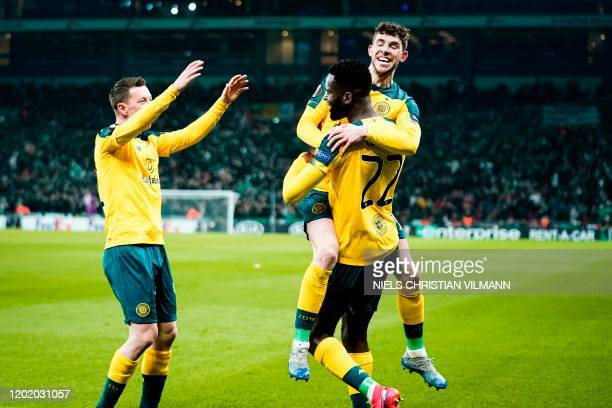 Celtic's Scottish midfielder Ryan Christie congratulates Celtic's French forward Odsonne Edouard for his goal during the Europa League last 32 first...