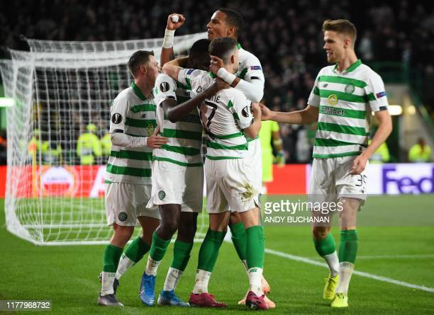 Celtic's Scottish midfielder Ryan Christie is mobbed by teammates after scoring the equalising goal during the UEFA Europa League group E football...