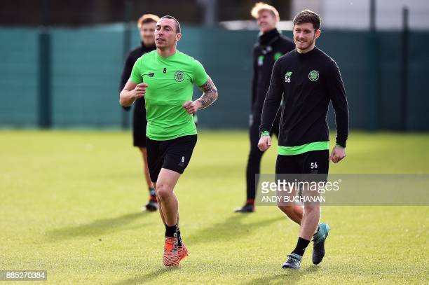 Celtic's Scottish midfielder Scott Brown and Celtic's Scottish defender Anthony Ralston attend a training session at the Celtic Training Centre in...