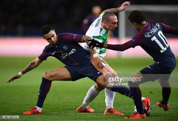 Celtic's Scottish midfielder Scott Brown fights for the ball with Paris SaintGermain's French defender Layvin Kurzawa and Paris SaintGermain's...