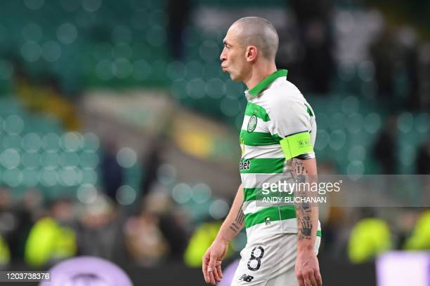 Celtic's Scottish midfielder Scott Brown reacts to their defeat on the pitch after the UEFA Europa League round of 32 second leg football match...