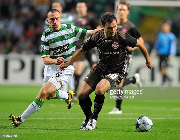 Celtic's Scottish midfielder Scott Brown vies with Aalborg's Polish forward Marek Saganowski during the Uefa Champions League group E football match...