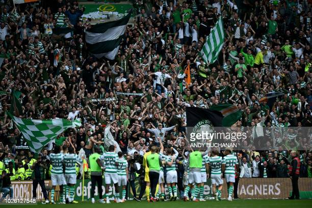 Celtic's supporters cheer the players after the Scottish Premiership football match between Celtic and Rangers at Celtic Park stadium in Glasgow...