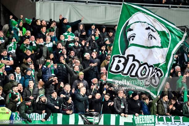 Celtic's supporters wave a giant flag before the UEFA Europa League group B football match Rosenborg BK v Celtic FC on November 29 2018 in Trondheim...