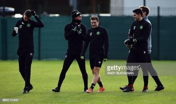 Celtic's Swedish defender Mikael Lustig Celtic's Scottish midfielder Liam Henderson Celtic's Scottish midfielder James Forrest and Celtic's...