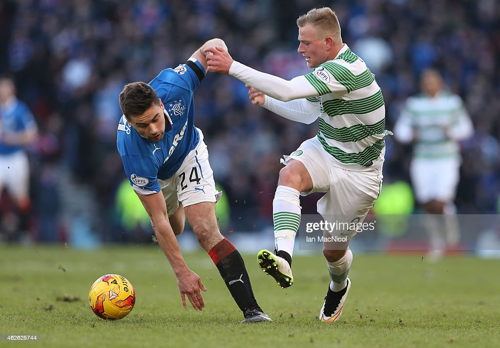 Celtic's Swedish forward John Guidetti vies with Darren McGregor during the Scottish League Cup Semi-Final football match between Celtic and Rangers at Hampden Park on February 01, 2015 in Glasgow, Scotland.