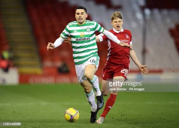 Celtic's Tom Rogic and Aberdeen's Jack MacKenzie battle for the ball during the Scottish Premiership match at Pittodrie Stadium, Aberdeen. Picture...