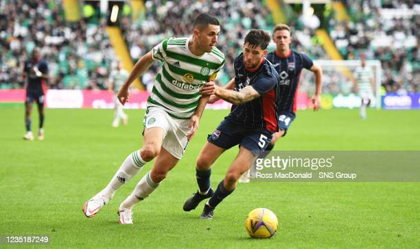 Celtic's Tom Rogic and Harry Paton in action during a cinch Premiership match between Celtic and Ross County at Celtic Park on September 11 in...