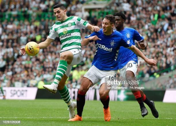 Celtic's Tom Rogic and Rangers Nikola Katic battle for the ball during the Ladbrokes Scottish Premiership match at Celtic Park Glasgow