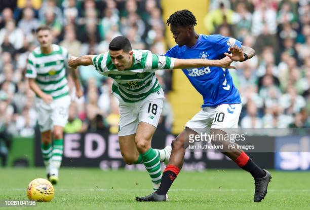 Celtic's Tom Rogic and Rangers Oviemuno Ejaria battle for the ball during the Ladbrokes Scottish Premiership match at Celtic Park Glasgow