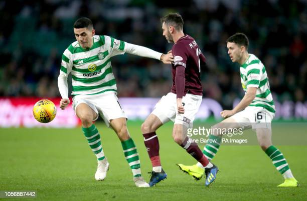 Celtic's Tom Rogic holds back Hearts' Michael Smith during the Ladbrokes Scottish Premier League match at Celtic Park, Glasgow.