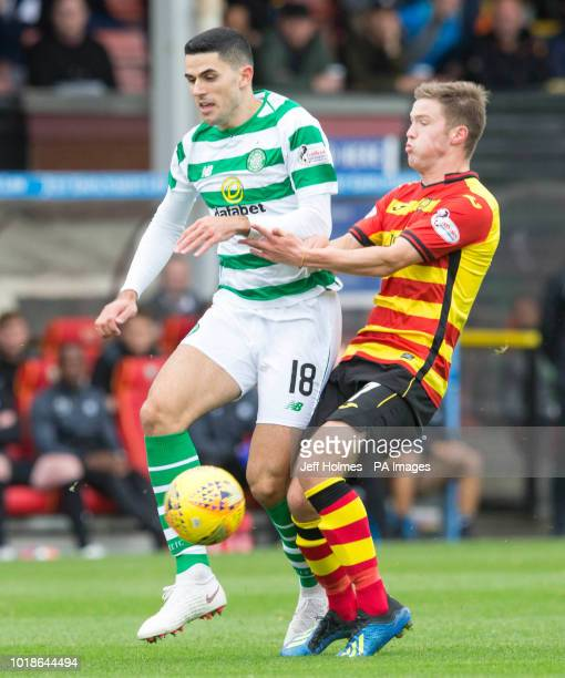 Celtic's Tom Rogic Partick Thistle's Blair Spittal during the Betfed Cup Second Round match at the Energy Check Stadium at Firhill Glasgow