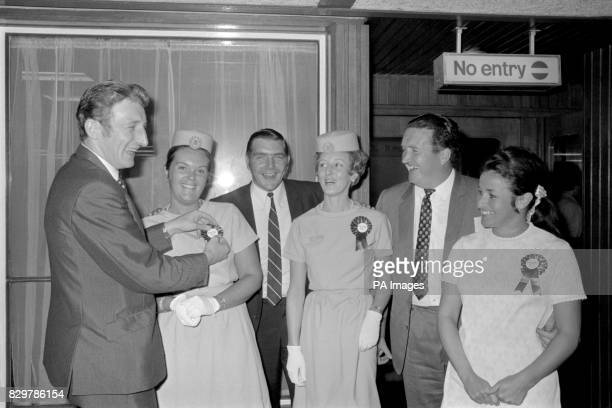 Celtic's Tommy Gemmell pins a rosette on the uniform of Air France stewardess Susan Ballantyne watched by teammate Bobby Murdoch manager Jock Stein...