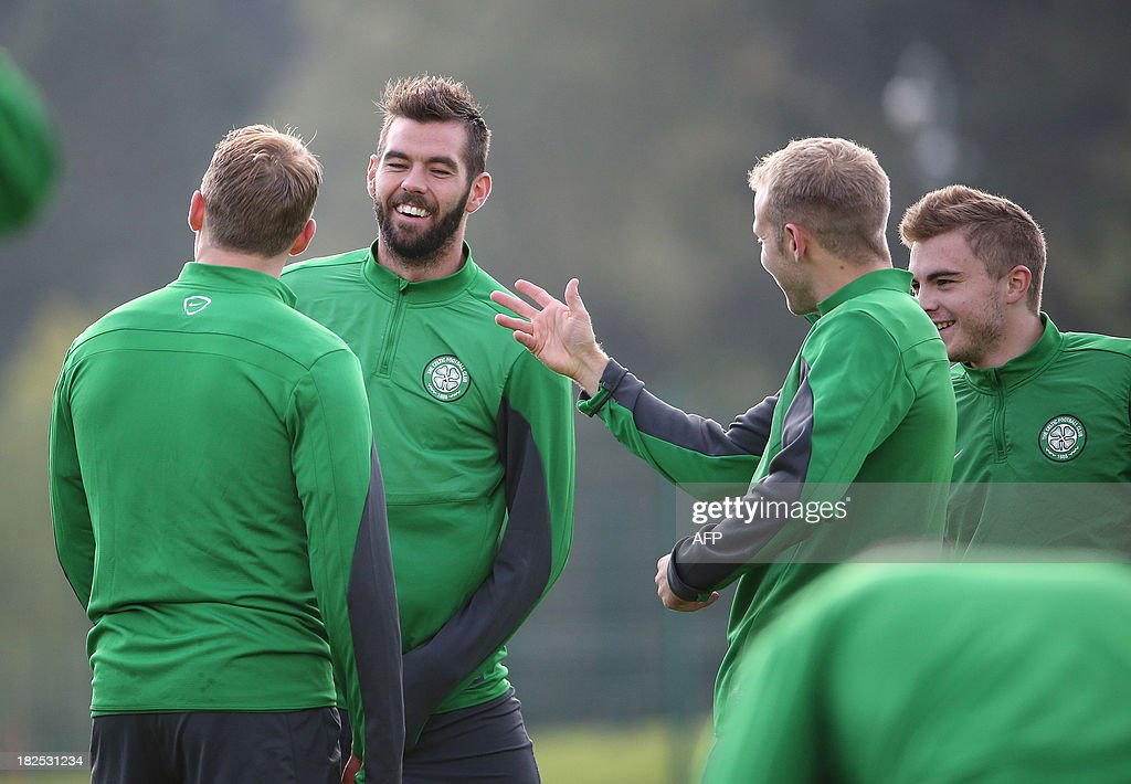 Celtic's Welsh midfielder Joe Ledley (2-L) looks on during a training session at Lennoxtown Training facility, near Glasgow, Scotland, on September 30, 2013 ahead of their UEFA Champions League last sixteen football match against Barcelona on October 1, 2013.
