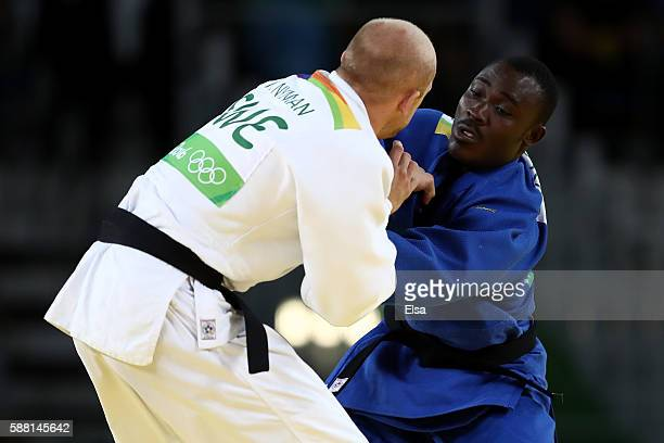 Celtus Williams Abiola Dossou Yovo of Benin competes against Marcus Nyman of Sweden during a Men's 90kg bout on Day 5 of the Rio 2016 Olympic Games...