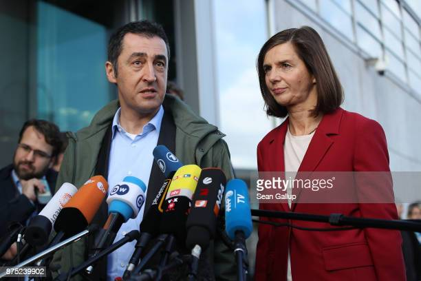 Cem Oezdemir and Katrin GoeringEckardt speak to the media as they arrive for further talks the morning after leaders of the four negotiating parties...