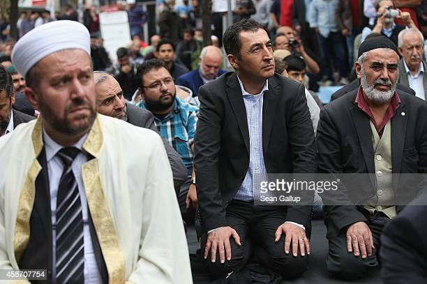 Cem Oezdemir coChairman of the German Greens Party joins Muslims who had gathered for Friday prayers on the street outside the Mevlana Moschee mosque...