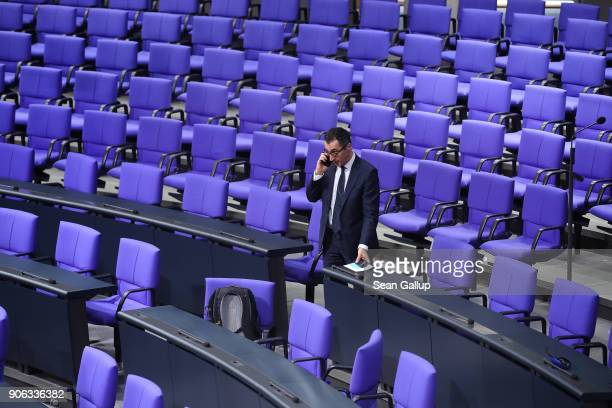 Cem Oezdemir of the German Greens Party speaks on a mobile phone following a memorial ceremony for late former Bundestag President Philipp Jenninger...