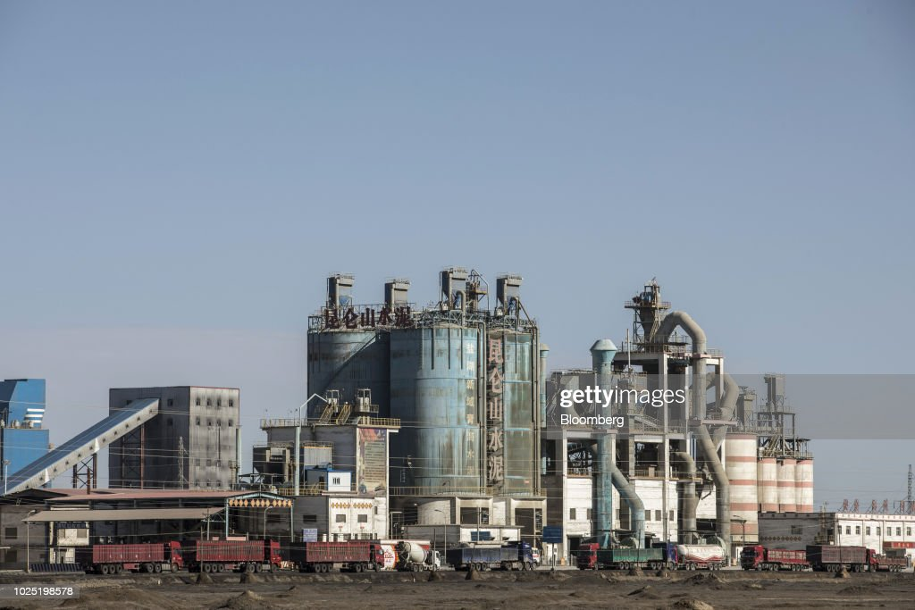 A cement factory stands in Golmud, Qinghai province, China, on Monday, July 23, 2018. Amid rising fears about a trade war, China's policy makers have unveiled measures to boost infrastructure construction and credit to smaller firms, as well as tax cuts. Photographer: Qilai Shen/Bloomberg via Getty Images
