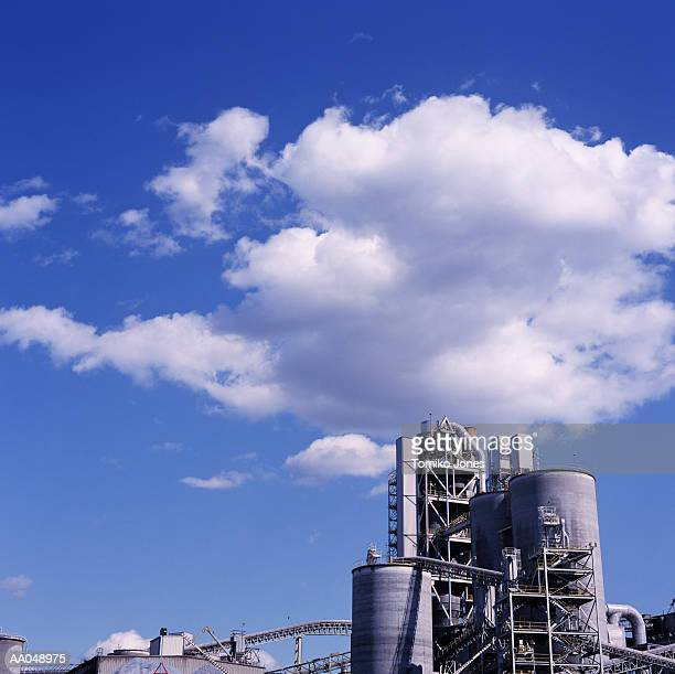 Cement factory with clouds