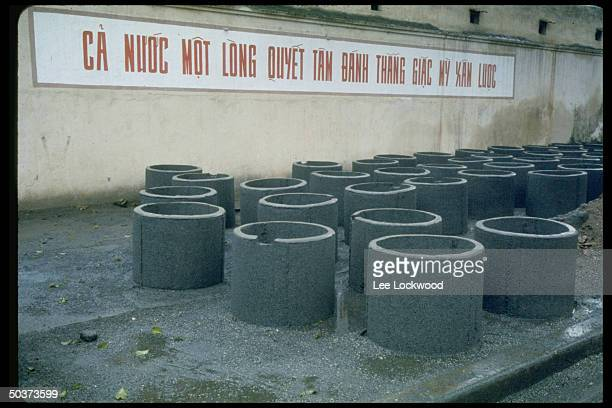 Cement liners for bomb shelters sitting on street