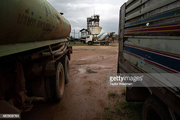 A cement truck and plant sit idle inside the Dawei SEZ on August 2 2015 in Nabule Myanmar The controversial multibillion dollar Dawei special...