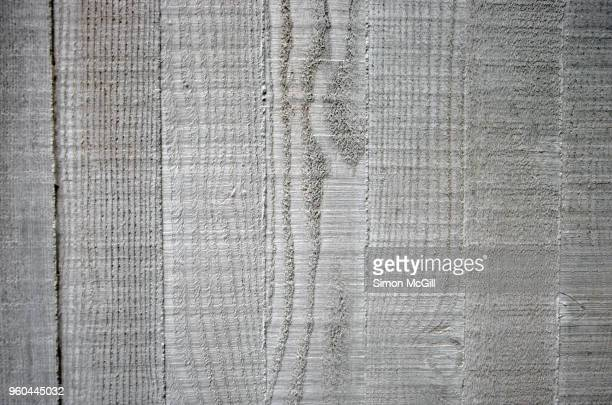 Cement wall with a wood grain fence paling pattern