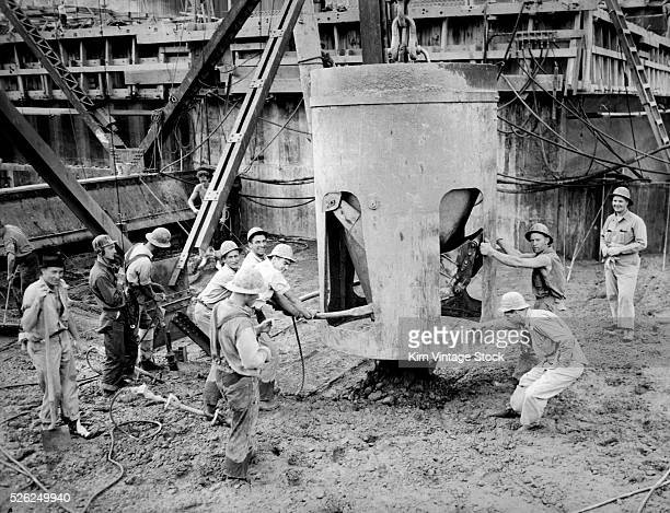 Cement workers lay a building foundation in downtown Chicago ca 1950