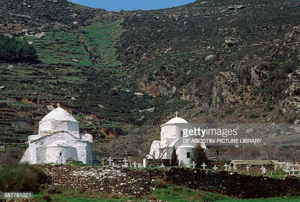A cemetery between two churches in Koronida left the church of Agios Georgios Naxos Island Cyclades Islands Greece