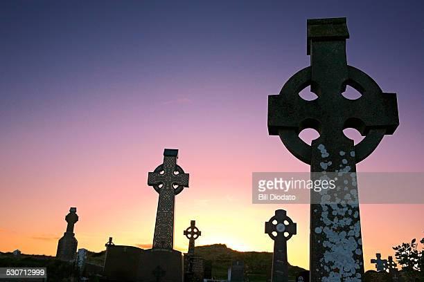cemetery crosses at dusk.