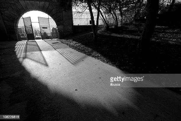 cemetery gates black and white - open grave stock photos and pictures