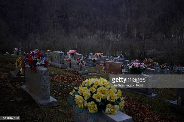 Cemetery graves stand on a hillside in Jackson Cemetery on Thursday November 21 2013 in Jackson Ky Due to poverty and the decline of the coal...